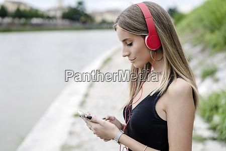 teenage girl at the riverside wearing
