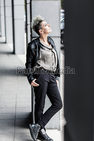 punk woman leaning against a column