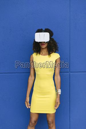 woman in yellow dress wearing virtual