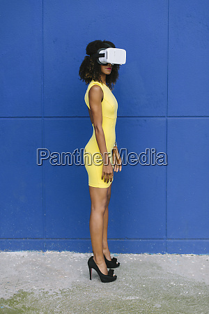 woman in yellow dress wearing virtual