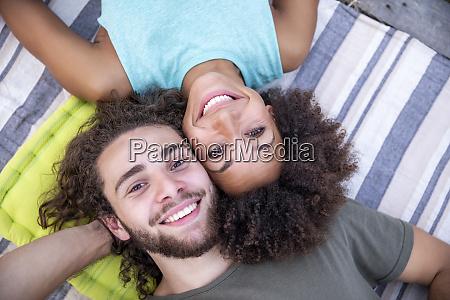 portrait of happy couple lying on