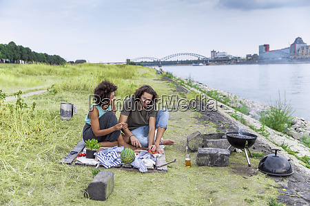 germany cologne couple having a barbecue