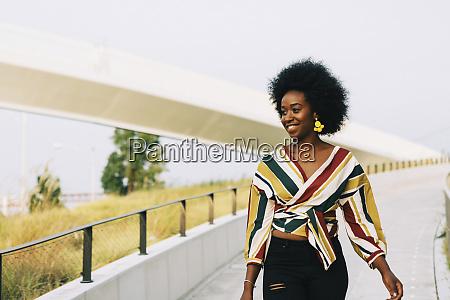 smiling young woman walking