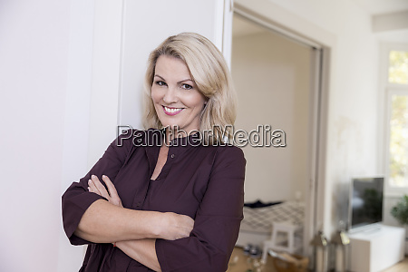 portrait of smiling blond mature woman