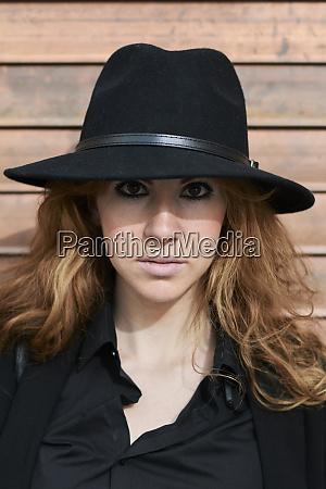 mid adult woman wearing black hat