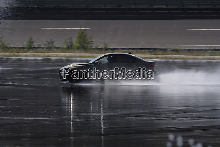 car driving on wet surface on