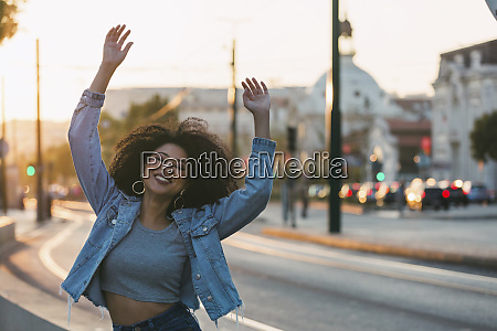 portrait carefree exuberant young woman on