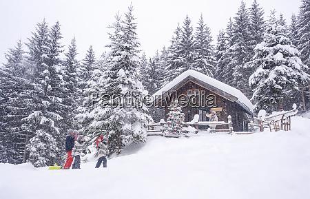 austria altenmarkt zauchensee family with sledges
