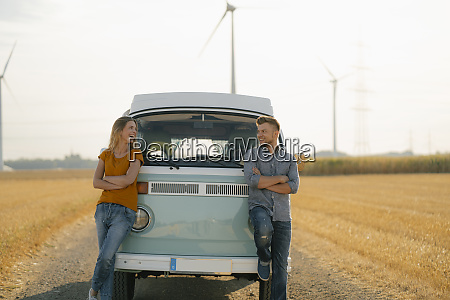 happy couple at camper van in