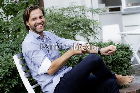 portrait of happy man sitting on