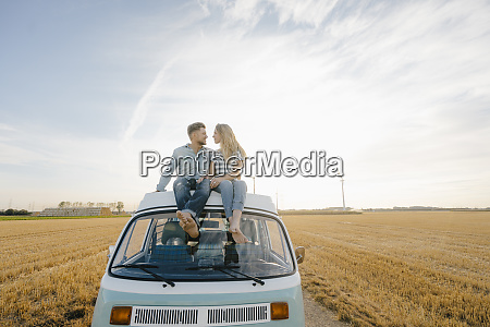 smiling young couple on roof of