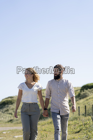 young couple taking a walk in