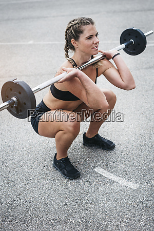 woman doing barbell exercise during weight