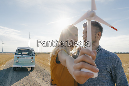 young couple at camper van in