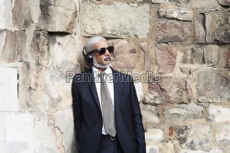 portrait of senior businessman in blue