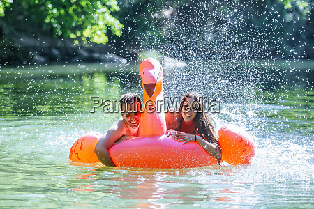 couple floating on water on an