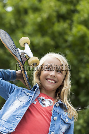 portrait of happy blond girl with