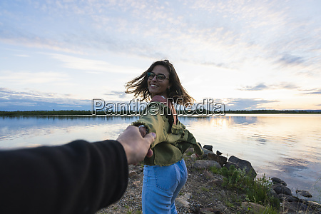 finland lapland happy young woman holding