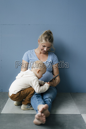toddler son and pregnant mother with