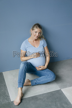 portrait of smiling pregnant woman sitting
