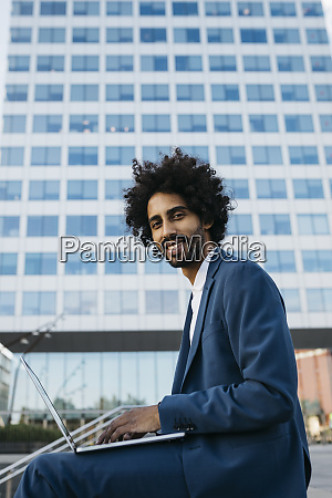 spain barcelona smiling young businessman sitting