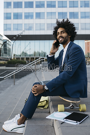 spain barcelona young businessman sitting outdoors