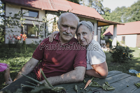 portrait of senior couple sitting at