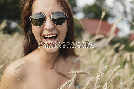 portrait of happy woman wearing sunglasses