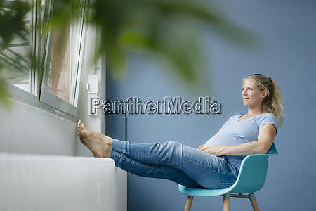 pregnant woman sitting on a chair
