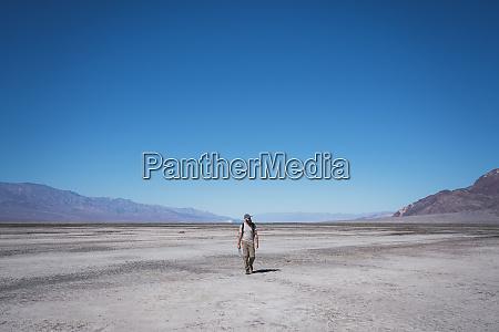 usa california death valley man walking