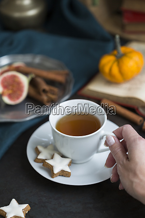 woman drinking cup of tea in