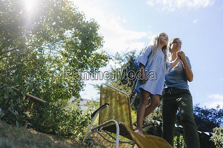 mother and daughter in garden looking