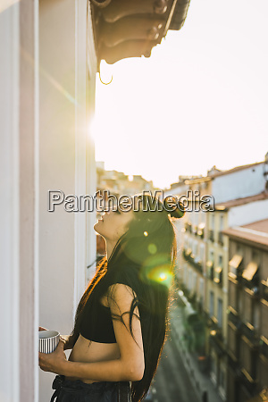 beautiful young woman on balcony above