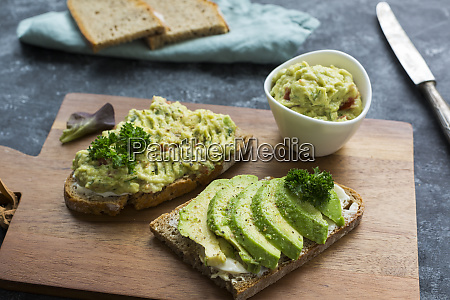 slices of bread with sliced avocado
