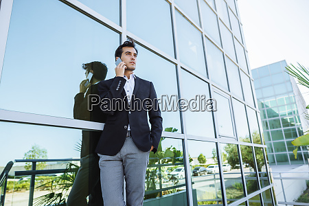 businessman on cell phone outside office
