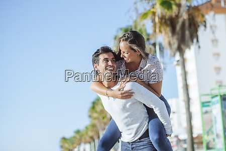 carefree young couple on promenade