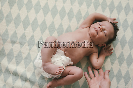 mothers hand and newborn baby boy