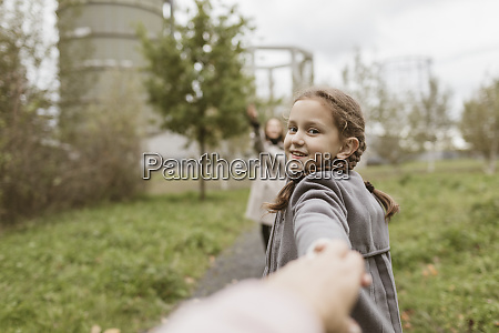 portrait of smiling girl holding hands