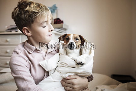 boy with jack russel terrier wrapped
