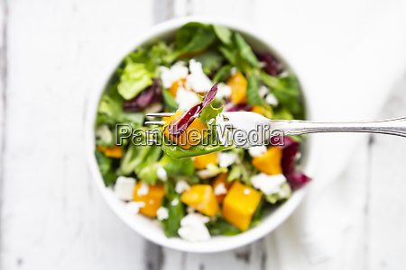 fork of autumnal salad with feta