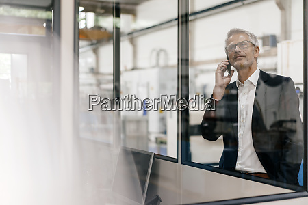manager talking on the phone in