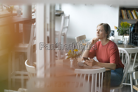young woman with cell phone sitting