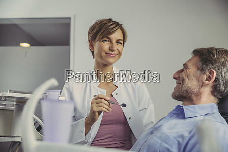 female dentist talking to her patient