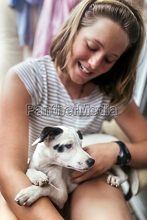puppy on girls lap