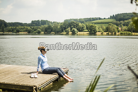 woman with vr glasses sitting on