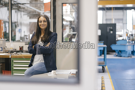 confident woman sitting in high tech
