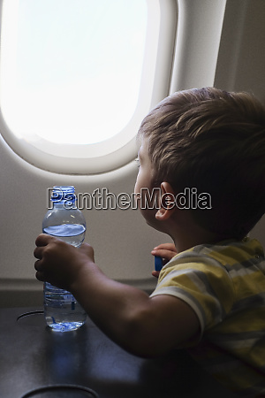 little boy in an airplane looking