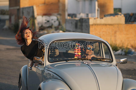 couple driving in a vintage car