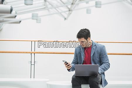 businessman in lobby of a modern