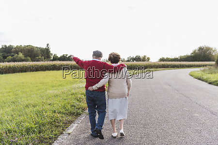 senior couple on a walk in